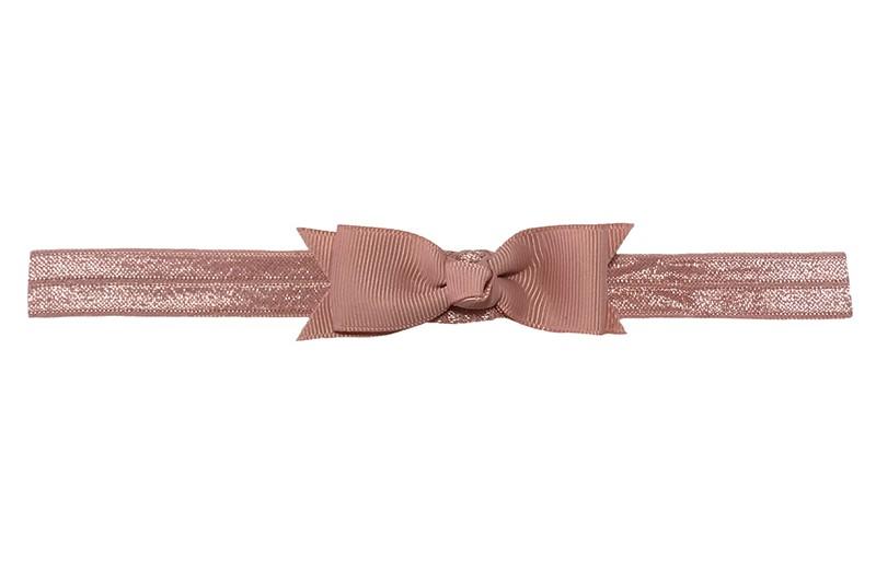 Schattig oud roze peuter kleuter haarbandje.  Met een oud roze strikje van lint.  Het haarbandje is van fijn rekbaar elastiek, geschikt tot en met ongeveer 5 jaar.