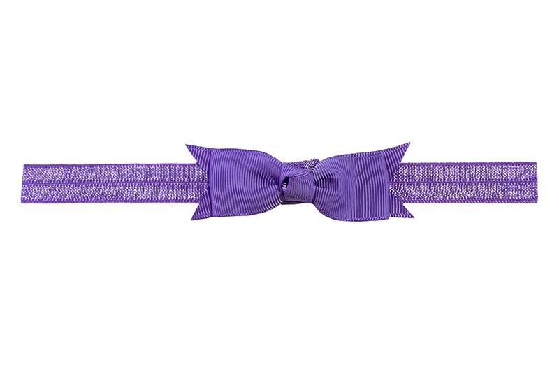Schattig paars peuter kleuter haarbandje.  Met een paars strikje van lint.  Het haarbandje is van fijn rekbaar elastiek, geschikt tot en met ongeveer 5 jaar.