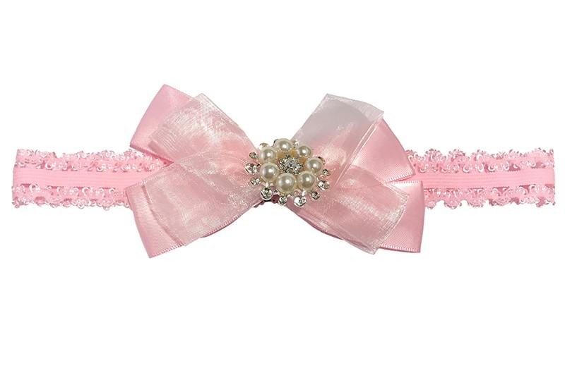 Schattig roze baby haarbandje in kantlook. Met een grote strik van 2 soorten lint. Afgewerkt met parels. Niet uitgerekt is het haarbandje ongeveer 16.5 centimeter.  De strik is ongeveer 7 centimeter.