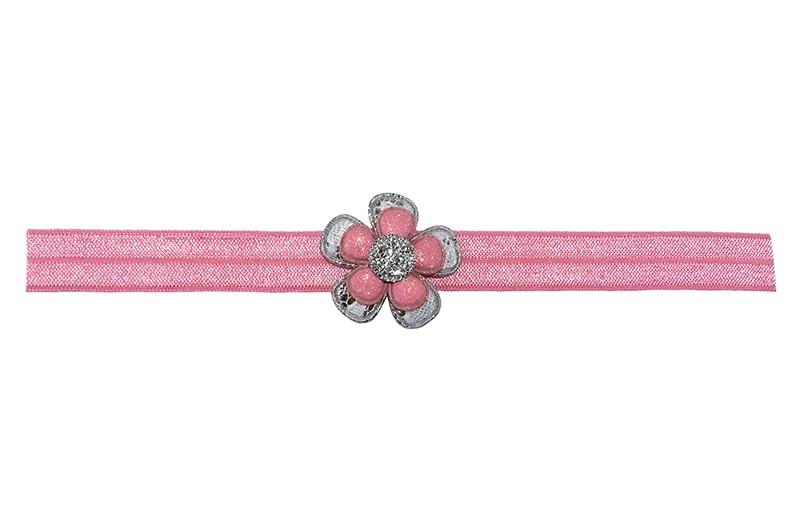 Schattig roze baby peuter haarbandje.  Met een zilver bloemetje in kantlook, een roze glitter bloemetje en een zilvergrijs steentje.  Het haarbandje is van goed rekbaar elastiek, geschikt tot en met ongeveer 3 jaar.
