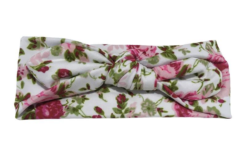 Schattig geknoopt baby, peuter, meisjes haarbandje. Van witte zachte rekbare stof met vrolijke roze roosjes en groene blaadjes motiefjes.  Het haarbandje is geknoopt in een leuk 'konijnenoortjes model'. Het haarbandje is ongeveer 7 centimeter breed.