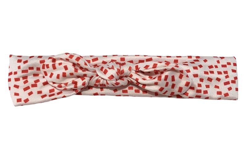 Schattig creme/wit stoffen peuter kleuter meisjes haarbandje.  Met vrolijk rood blokjes dessin.  Het haarbandje is van goed rekbare stof geschikt tot en met ongeveer 6 jaar.