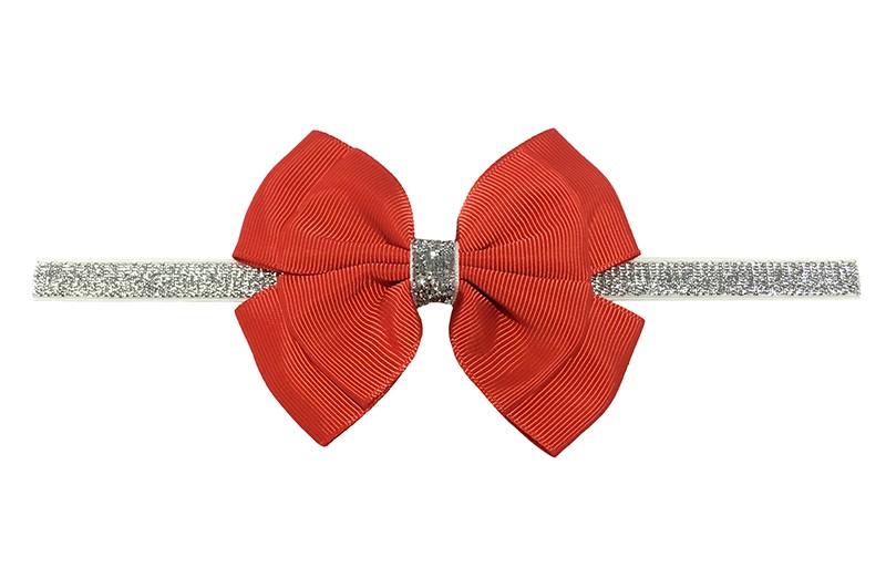Schattig zilver glitter baby peuter meisjes haarbandje met mooie grote dubbel geknoopte rode strik.  Het haarbandje is van goed rekbaar elastiek, geschikt voor baby meisjes en peuter meisjes tot en met ongeveer 3 jaar.  Niet uitgerekt is de omtrek van het haarbandje ongeveer 36 cm.