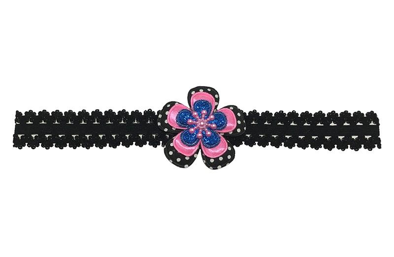 Leuk zwart baby peuter haarbandje in kantlook.  Met een zwart met wit gestippeld bloemetje, een effen fel roze bloemetje, een blauw glitter  bloemetje en een roze ijssterretje. Het haarbandje is van goed rekbaar elastiek.  Niet uitgerekt is het haarbandje ongeveer 18.5 centimeter.
