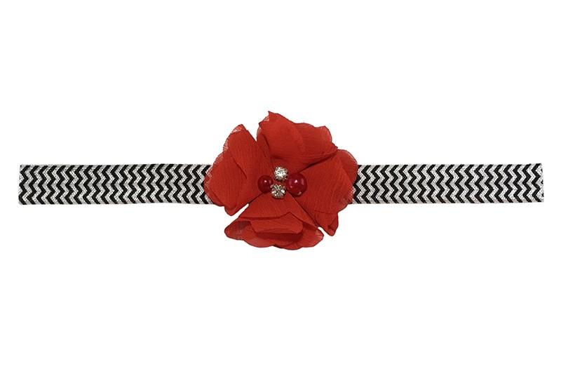 Vrolijk wit peuter kleuter meisjes haarbandje met zwart zigzagpatroontje.  Met een rood chiffon bloemetje met 4 verschillende pareltjes.  Het haarbandje is van goed rekbaar elastiek, geschikt tot en met ongeveer 5 jaar.