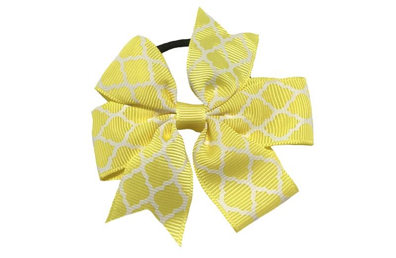 Stevige zwarte haarelastiek met een gele strik van lint met vrolijk wit lijntjes patroontje,  Leuk in allerlei peuter en kleuter kapseltjes.
