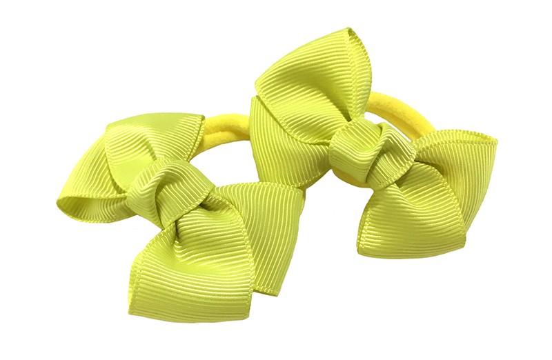 Vrolijk setje van 2 fel gele zachte haarelastiekjes met op elk een leuk fel geel strikje van lint.