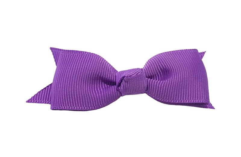 Mooi haarstrikje van paars lint op een handig alligatorknipje. Leuk voor kleine meisjes en grotere meisjes.