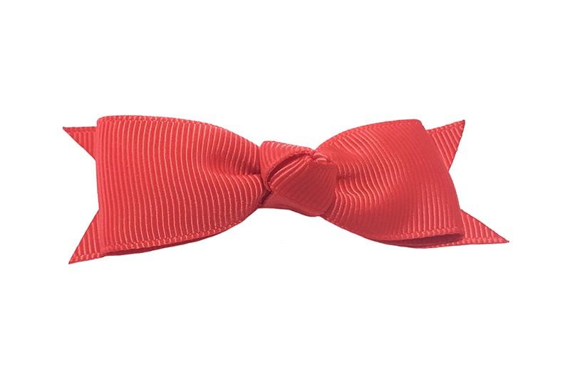 Mooi haarstrikje van rood lint op een handig alligatorknipje. Leuk voor kleine meisjes en grotere meisjes.