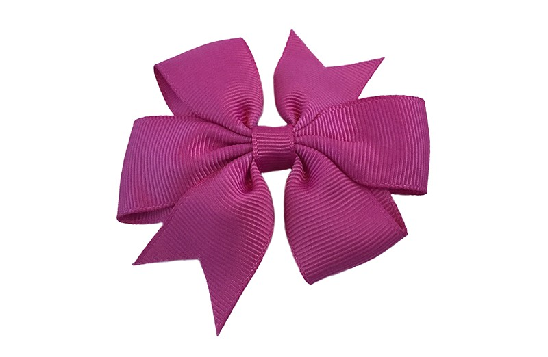 Mooi! Grote framboos roze haarstrik op een alligator speldje makkelijk in het haar te zetten.