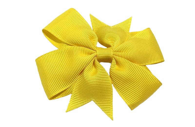 Vrolijke grote gele haarstrik op een alligator speldje makkelijk in het haar te zetten.