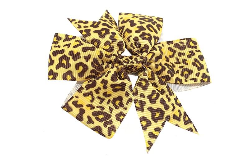 Leuke grote gele haarstrik met bruin dierenprintje.  Op een platte haarknip bekleed met geel lint.