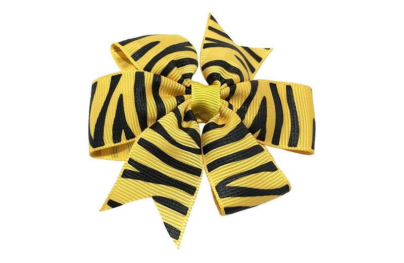 Leuke grote gele haarstrik met zwarte streepjes. Op een platte haarknip bekleed met geel lint.