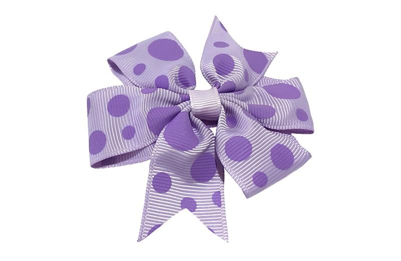 Leuke grote lila haarstrik met paarse stippen. Op een platte haarknip bekleed met lila lint.