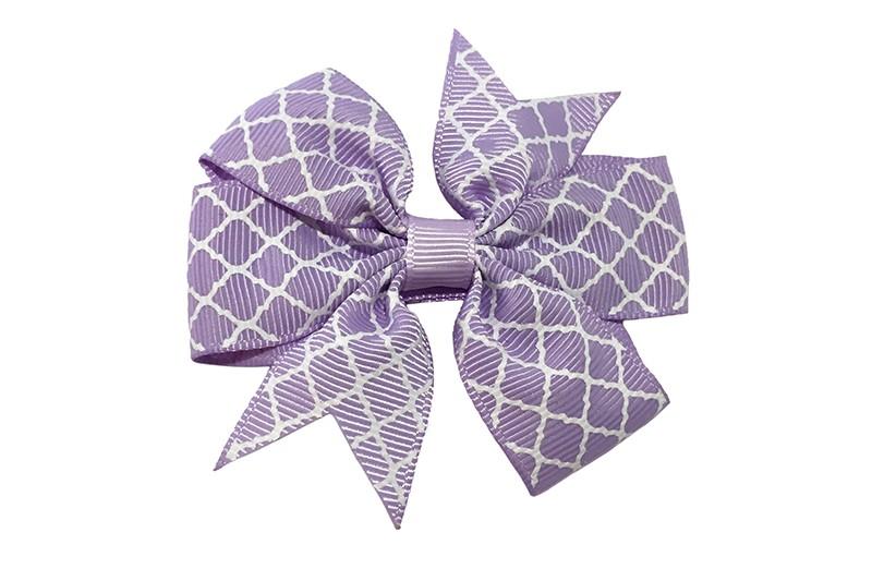 Vrolijke grote lila paarse haarstrik met witte lijntjes.  Op een platte haarknip bekleed met lila paars lint.