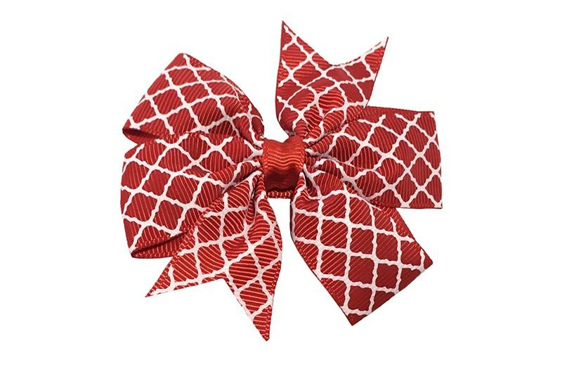 Vrolijke grote rode haarstrik met witte lijntjes.  Op een platte haarknip bekleed met rood lint