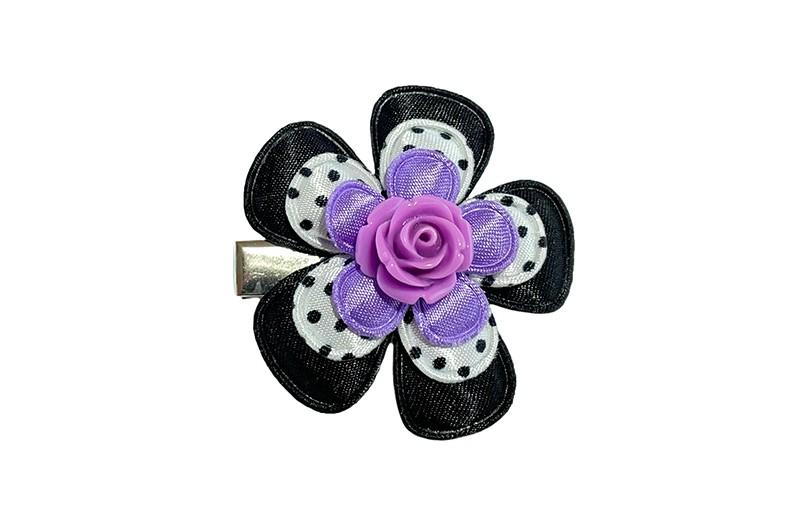 Vrolijk peuter kleuter meisjes haarknipje. Met een effen zwart bloemetje, een wit bloemetje met zwarte stippeltjes en een effen paars bloemetje.  Afgewerkt met een lila steentje in de vorm van een roosje.