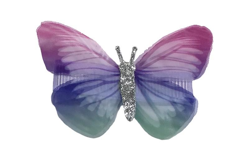 Vrolijk peuter haarknipje met een vlindertje in paars roze en groen tinten. Het knipje is 3.5 centimeter en bekleed met lila lint.