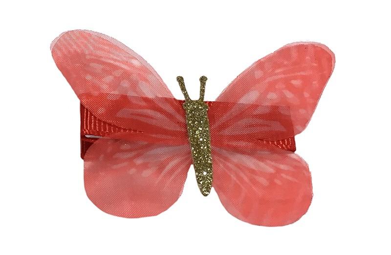 Vrolijk rood peuter haarknipje met rood vlindertje. Het knipje is 3.5 centimeter en bekleed met rood lint.