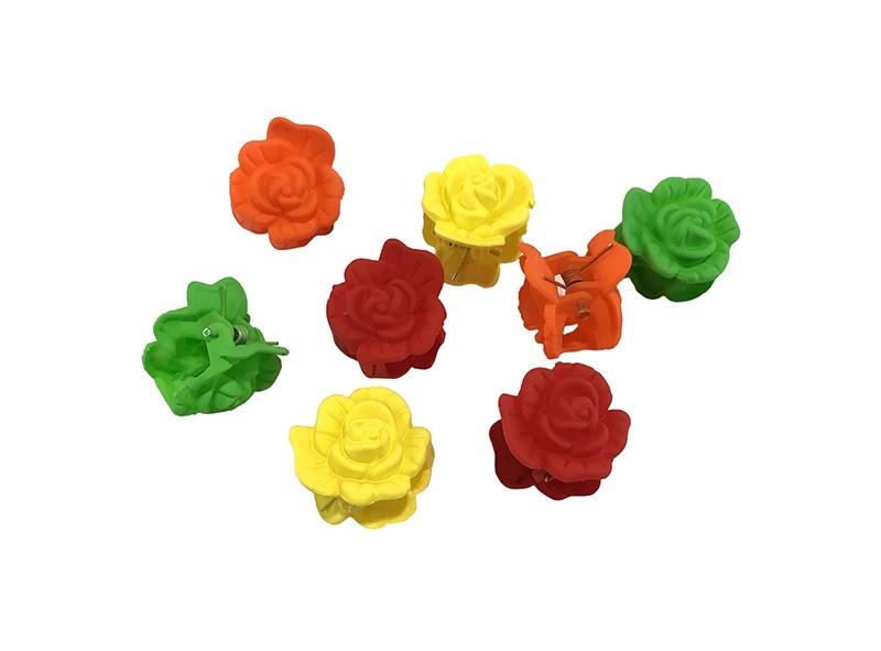 Handig setje van 8 kleine haarknipjes in de vorm van een roosje.  In de vrolijke kleurtjes geel, groen, rood en oranje.  Handig om bijvoorbeeld de haartjes in een vrolijk dotje vast te zetten.