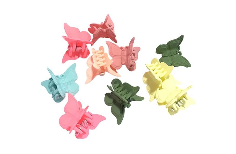 Vrolijk setje van haarknipjes in de vorm van een vlindertje.  In vrolijke kleurtjes groen, blauw, geel en roze.