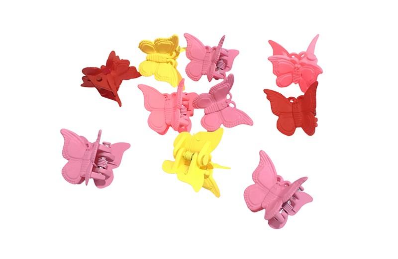Vrolijk setje van haarknipjes in de vorm van een vlindertje. In vrolijke kleurtjes roze, geel en rood.