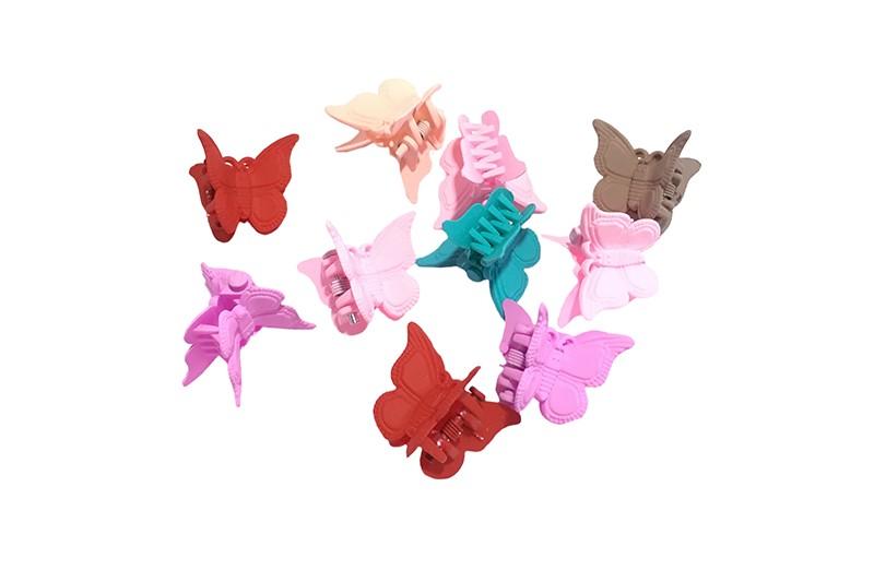 Vrolijk setje van 10 haarknipjes in de vorm van een vlindertje.  In vrolijke kleurtjes roze, rood, taupe en groen.