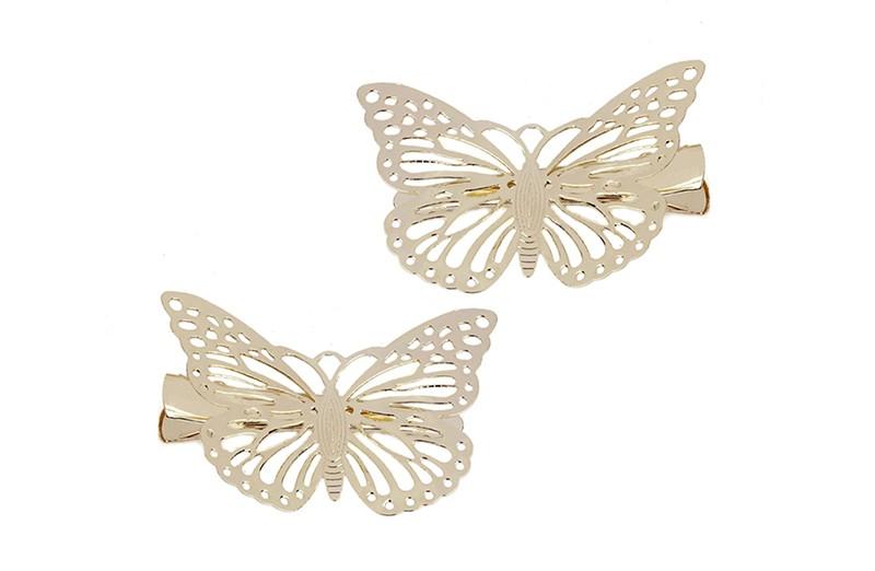 Setje van 2 goudkleurige haarknipjes met op elk een goud vlindertje.
