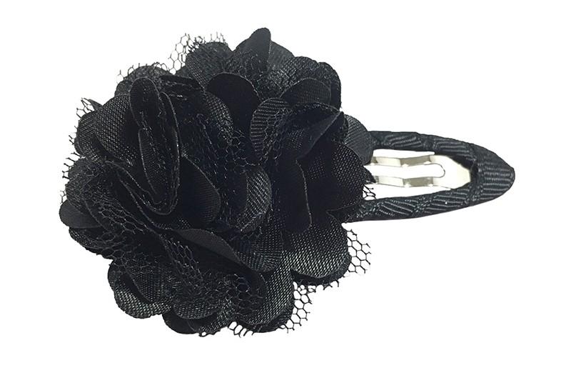 Leuke zwarte haarspeld bekleed met zwart lint.  Met een vrolijke zwarte laagjes bloem.