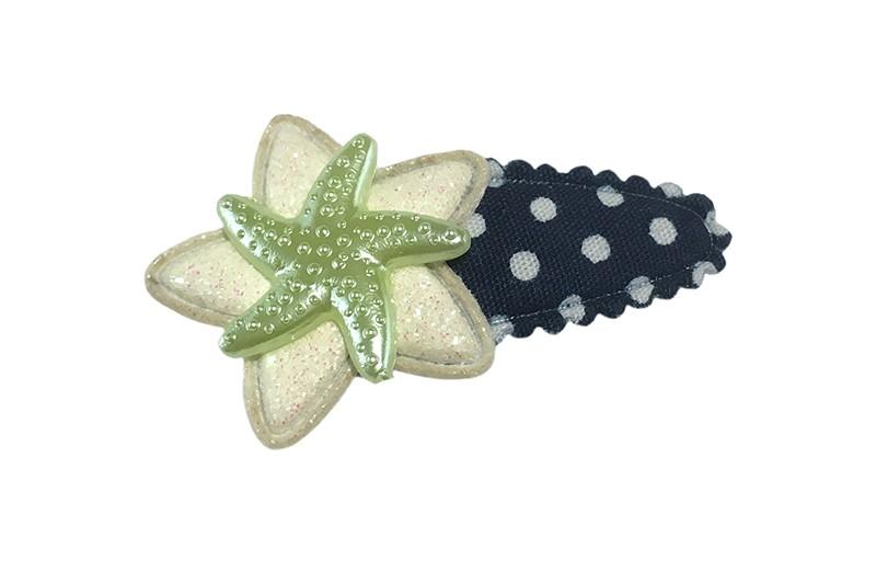 Vrolijk donkerblauw baby peuter haarspeldje met witte stippeltjes.  Met een wit glitterbloemetje en een mintgroen zeesterretje.