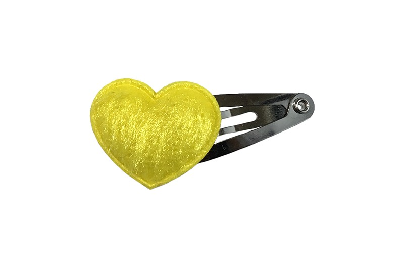 Vrolijk baby haarspeldje met een fel geel hartje.