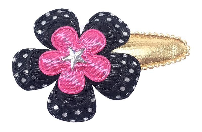 Vrolijk gouden haarspeldje met een zwart wit gestippelde bloem, een effen zwarte bloem en een effen fel roze bloem. Afgemaakt met een klein sterretje.