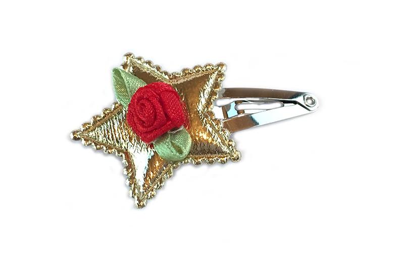 Leuk haarspeldje met glimmende gouden ster. Afgewerkt met een rood roosje.