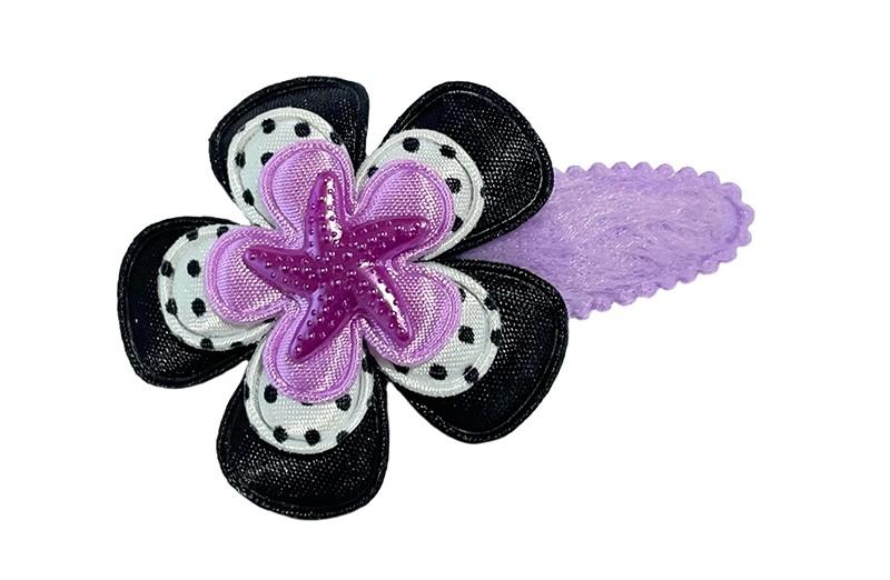 Vrolijk fluffie lila paars peuter kleuter haarspeldje.  Met een effen zwart bloemetje, een wit bloemetje met zwarte stippeltjes en een effen lila paars bloemetje.  Afgewerkt met een paars zeesterretje.