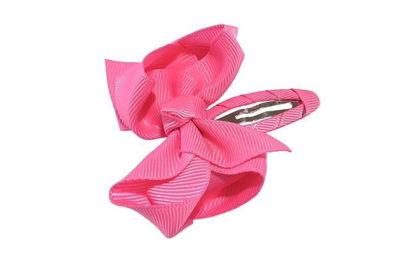 Vrolijk  peuter kleuter haarspeldje bekleed met fel roze lint.  Met een fel roze strikje van geribbeld lint. In een mooie dubbel geknoopte look.