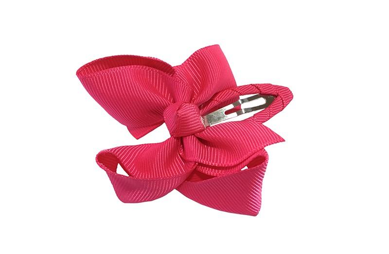 Vrolijk peuter kleuter haarspeldje bekleed met fuchsia roze lint.  Met een fuchsia roze strikje van geribbeld lint. In een mooie dubbel geknoopte look.
