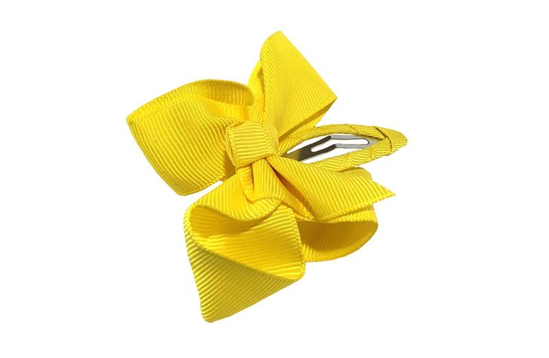 Vrolijk peuter kleuter haarspeldje bekleed met geel lint.  Met een geel strikje van geribbeld lint. In een mooie dubbel geknoopte look.