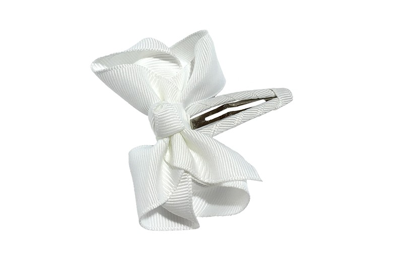 Vrolijk  peuter kleuter haarspeldje bekleed met wit  lint.  Met een wit strikje van geribbeld lint. In een mooie dubbel geknoopte look.