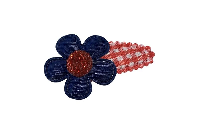 Vrolijk rood wit geruit baby peuter haarspeldje.  Met een donkerblauw bloemetje en een rood pareltje.