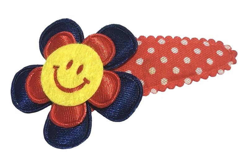 Leuk rood gestippeld peuter kleuter haarspeldje.  Met een donkerblauw bloemetje, rood bloemetje en een vrolijke gele smiley.