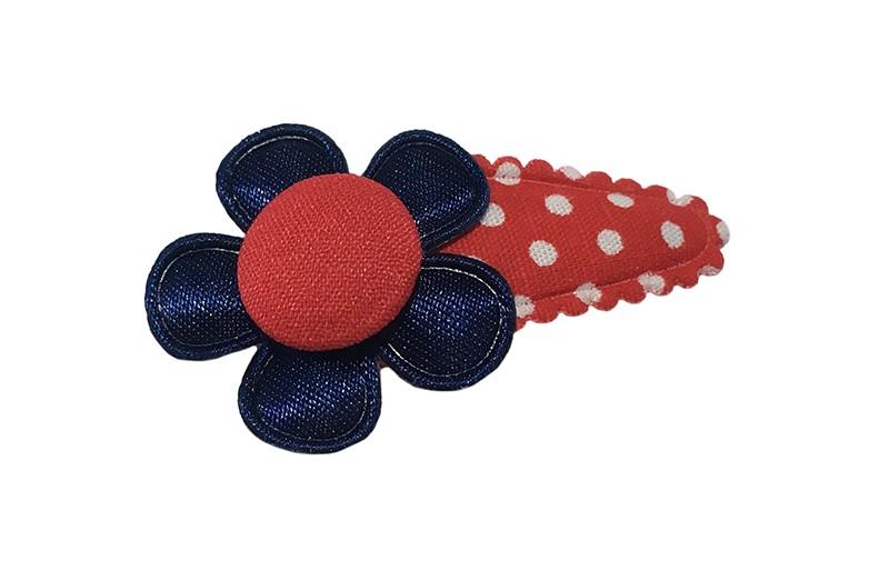 Vrolijk baby peuter haarspeldje rood met witte stippeltjes. Met een effen donkerblauw bloemetje en een rood stofknoopje.