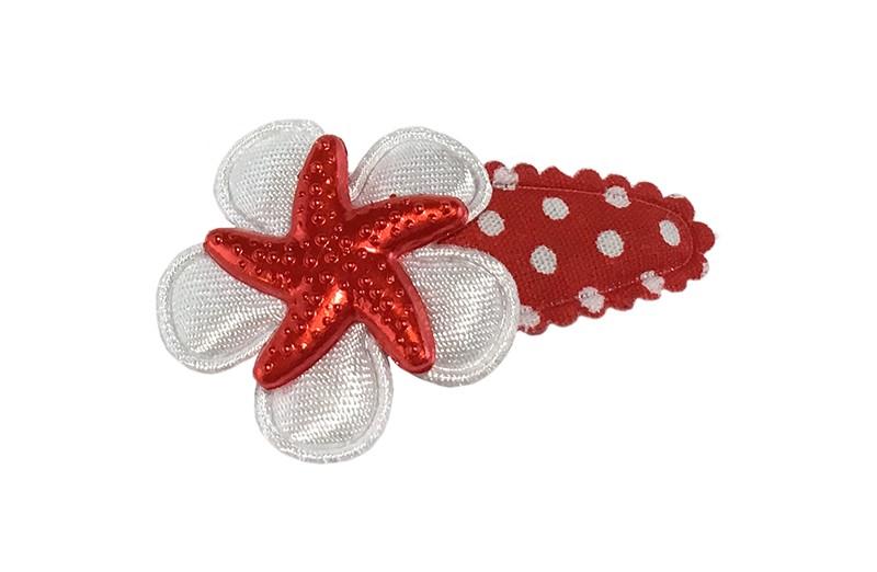Vrolijk rood gestippeld baby peuter haarspeldje.  Met een wit bloemetje en een rood zeesterretje.