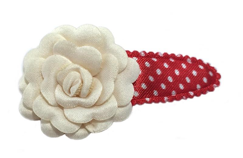 Vrolijk rood met wit gestippeld meisjes haarspeldje. Afgewerkt met luxe creme bloem.