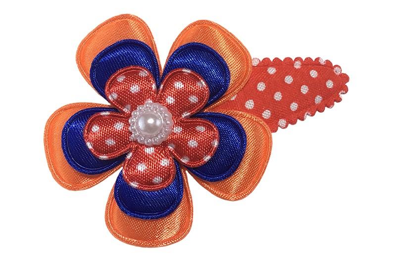 Hollands gekleurd! Vrolijk rood wit gestippeld peuter kleuter haarspeldje.  Met een glanzende oranje bloem, een glanzend blauwe bloem en een rood bloemetje met witte stippeltje.  Afgewerkt met een klein wit pareltje.