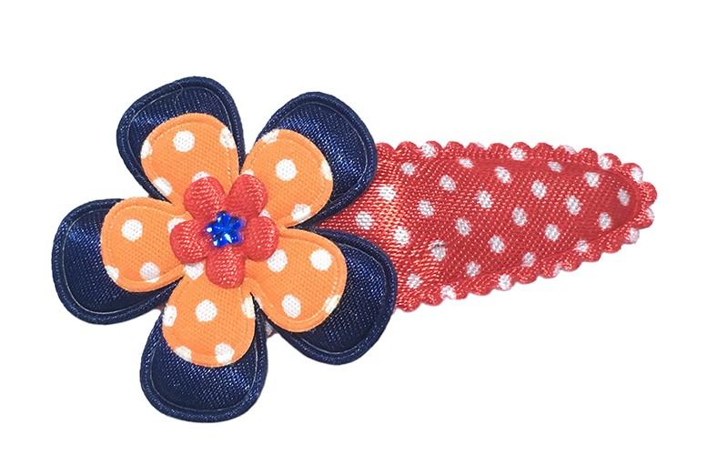 Vrolijk rood haarspeldje met witte stippeltjes met een glanzend donkerblauwe bloem, een fel oranje bloemetje met witte stippeltjes en een rood bloemetje afgewerkt met een blauw glimmertje.