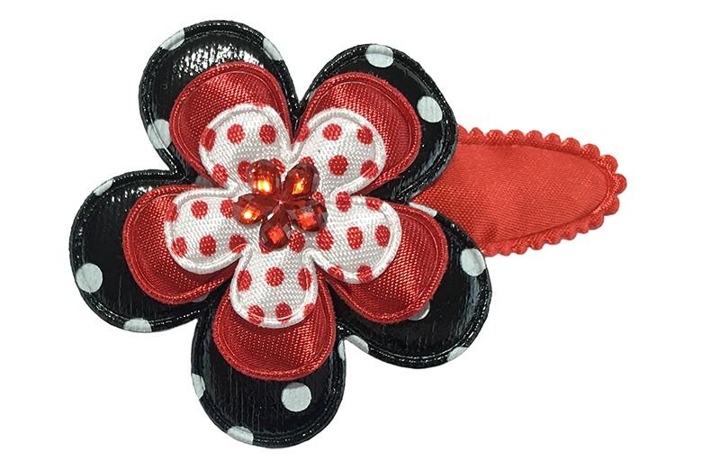Vrolijk effen rood peuter kleuter haarspeldje.  Met een zwart bloemetje met witte stippels, een effen rood bloemetje en een wit bloemetje met rode stippels.  Afgewerkt met een rood glinsterbloemetje.