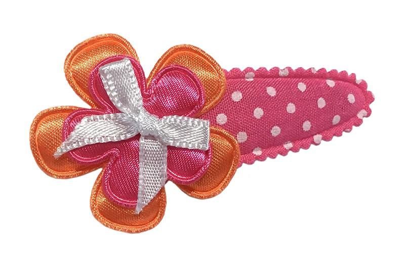 Vrolijk roze peuter kleuter haarspeldje met witte stippeltjes. Met een oranje bloemetje en een fel roze bloemetje. Afgewerkt met een lief wit strikje.