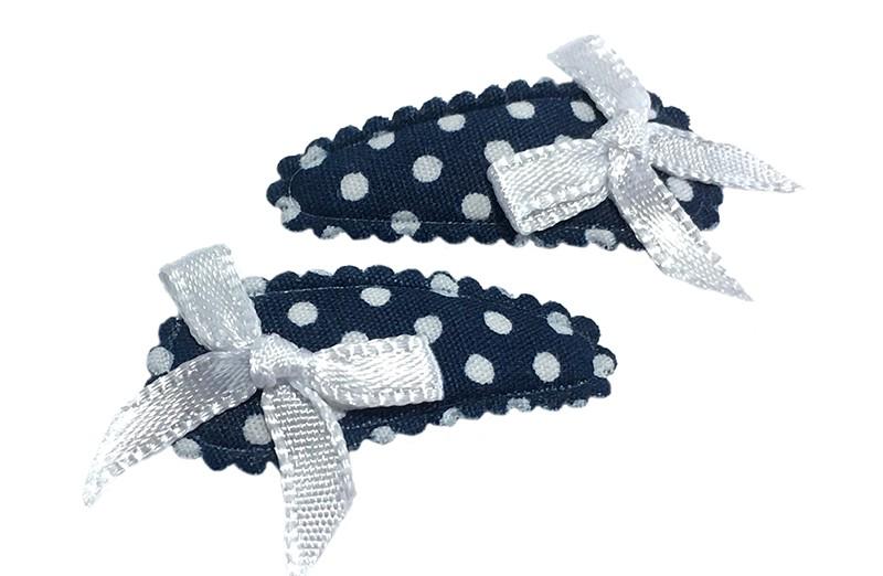 Lief setje van 2 donkerblauwe baby, peuter haarspeldjes met witte stippeltjes. Met op elk een wit strikje.