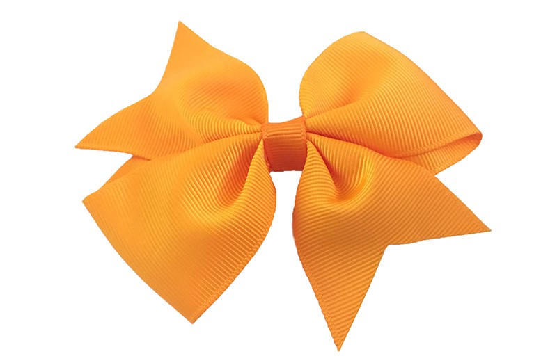 Leuke enkele haarstrik in oranje kleur op alligator knip  Leuk voor zowel jonge meisjes als oudere meisjes.