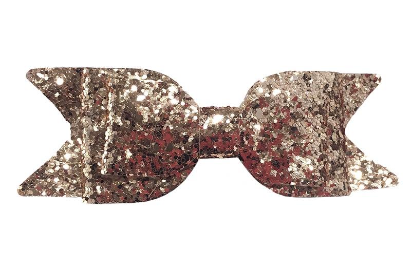 Mooie champagne kleur glitter haarstrik. Op een gebogen haarspeld. De haarspeld, het gedeelte dat in het haar vast klikt, is ongeveer 5 centimeter.